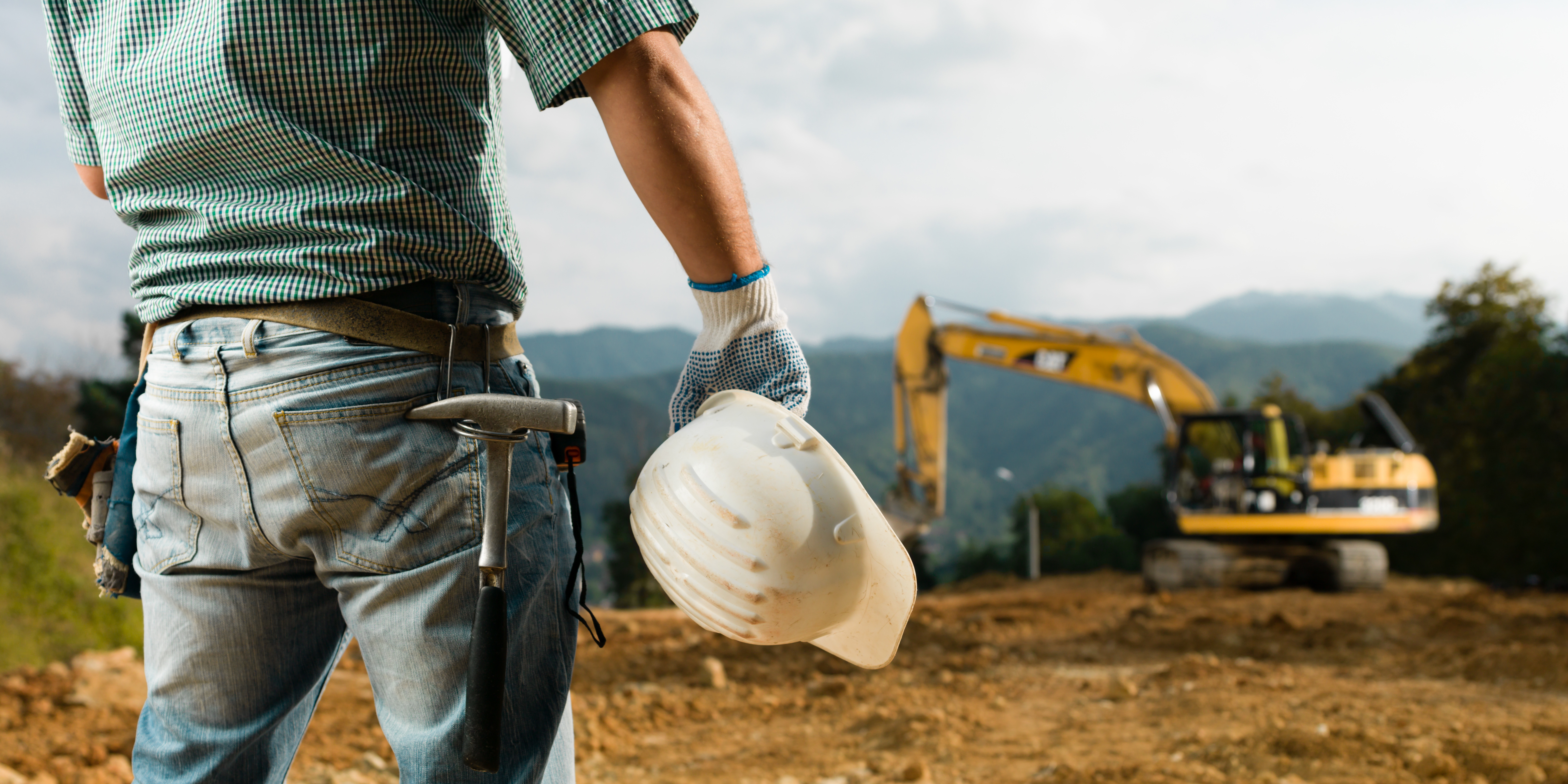lone worker, construction worker, tractor, hard hat
